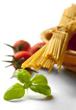 Spaghetti, cherry tomatoes and fresh basil Royalty Free Stock Photos
