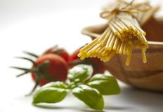 Spaghetti, cherry tomatoes and fresh basil Stock Image