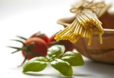 Spaghetti, cherry tomatoes and fresh basil Stock Image