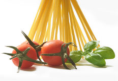 Spaghetti, cherry tomatoes and fresh basil Stock Photo