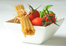 Spaghetti, cherry tomatoes and fresh basil Royalty Free Stock Image