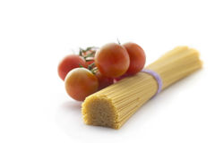 Spaghetti and cherry tomatoes isolated on white Stock Photos