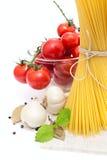 Spaghetti, cherry tomatoes, onions, garlic Stock Image