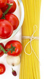 Spaghetti, cherry tomatoes, onions, garlic Royalty Free Stock Photo