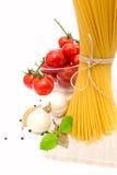 Spaghetti, cherry tomatoes, onions, garlic, bay Stock Photo