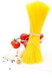 Spaghetti, cherry tomatoes, onions, garlic, bay Royalty Free Stock Images