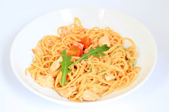 Spaghetti with chicken, cherry tomatoes and rucola Royalty Free Stock Photo