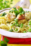 Spaghetti with chicken meatball and green pea. Stock Photography