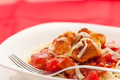 Spaghetti with chicken nuggets Royalty Free Stock Photos