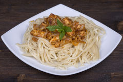 Spaghetti with chicken and vegetable on a plate Stock Photos