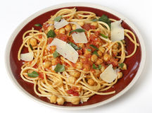 Spaghetti with chickpeas and parmasan Stock Photos
