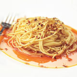 Spaghetti in chili oil Stock Photo