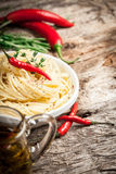 Spaghetti with chilli. Organic food. Spaghetti with chilli. on wooden table Royalty Free Stock Photos