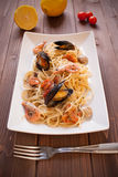 Spaghetti with clams, crayfish and shrimp Stock Image