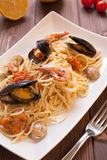 Spaghetti with clams, crayfish and shrimp Stock Photos