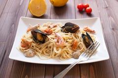 Spaghetti with clams, crayfish and shrimp Stock Photo