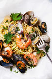 Spaghetti with clams, prawns, sea scallops Royalty Free Stock Image