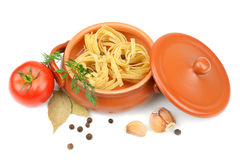 Spaghetti in a clay pot Royalty Free Stock Photo