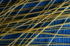 Spaghetti. Close view of raw spaghetti on blue background Stock Photography