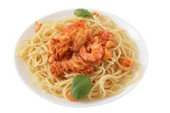 Spaghetti with codfish and shrimps Stock Images
