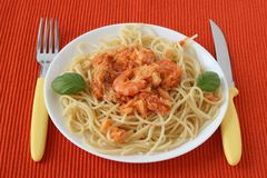 Spaghetti with codfish, shrimps Royalty Free Stock Images
