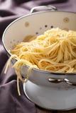 Spaghetti in colander. Closeup shot of spaghetti in colander Royalty Free Stock Photo