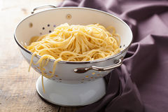 Spaghetti in colander Stock Images