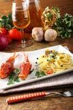Spaghetti con il brodo fresco dei frutti di mare Immagini Stock Libere da Diritti