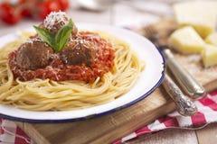 Spaghetti con le polpette ed il parmigiano Fotografia Stock