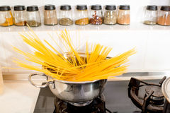 spaghetti cooking on the gas stove Stock Photos