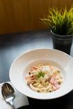 Spaghetti cream sauce ham and mushroom serve on white dish. Stock Photography