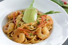 Spaghetti with cream Tom Yam Goong Stock Photo