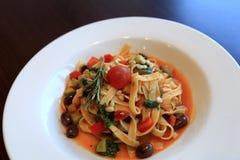 Spaghetti Crudaiola in italian restaurant Royalty Free Stock Image