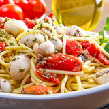 Spaghetti with cuttlefish and tomatoes Stock Images