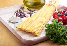 Spaghetti on desk. Ingredients for cooking italian pasta Stock Image