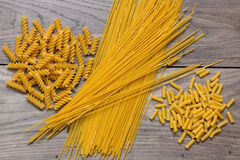 Spaghetti, and different types of pasta on top of a table Stock Images