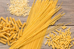 Spaghetti, and different types of pasta on top of a table Royalty Free Stock Image