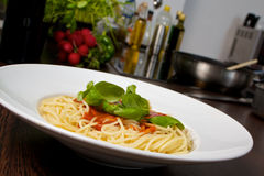 Spaghetti dinner. Spaghetti with tomato sauce and basil Royalty Free Stock Photography
