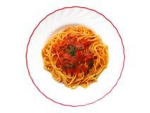 Spaghetti dish. Italian spaghetti with tomato and parsley Royalty Free Stock Images