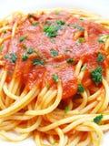 Spaghetti dish. Italian spaghetti with tomato and parsley Royalty Free Stock Photos