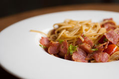 Spaghetti with dried chilli ,bacon and garlic. Royalty Free Stock Photos