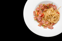 Spaghetti with dried chilli ,bacon and garlic. Stock Photos