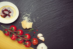 Spaghetti, dried tomatoes, cheese, thyme. Stock Photography
