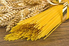 Spaghetti and ears of corn Stock Photo
