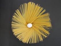 Spaghetti and egg, spaghetti, egg, one egg and pasta, pastas, long pastas, long pasta Royalty Free Stock Images