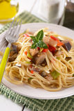 Spaghetti with eggplant and peppers Stock Photo