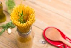 Spaghetti et romarin Photographie stock