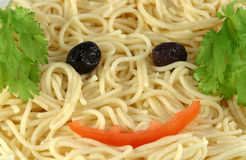 Spaghetti face. A happy face in a plate of spaghetti Royalty Free Stock Image