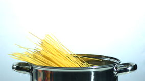 Spaghetti falling into a pot. In slow motion stock video