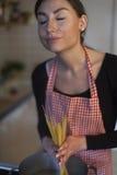 Spaghetti. Female cook in an apron making spaghetti Stock Photos